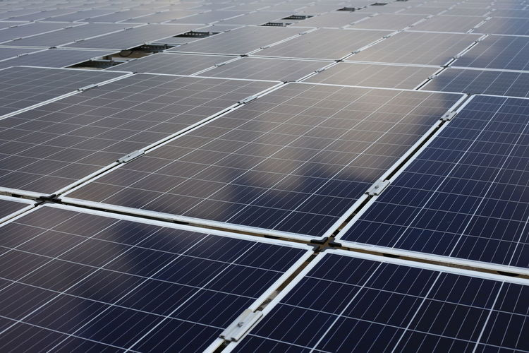 large scale solar farm Alternative Energy Backgrounds Business Economy Electricity  Environment Environmental Conservation Environmental Issues Fuel And Power Generation Full Frame Nature Pattern Power Supply Renewable Energy Sky Solar Energy Solar Equipment Solar Panel Solar Power Station Sun Sustainable Resources Technology
