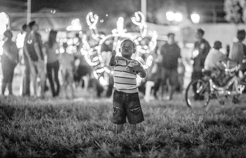 Casual Clothing Enjoyment Field Focus On Foreground Fun Grass Grassy Illuminated Leisure Activity Lifestyles Outdoors Selective Focus