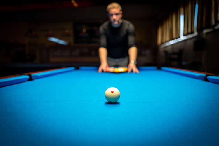 Billiard Pool Table Pool Ball Sport Table Pool - Cue Sport Ball Pool Cue Leisure Activity Playing Concentration Indoors  One Person Skill  Accuracy Front View Young Adult Leisure Games Relaxation Young Men Aiming Pool Hall