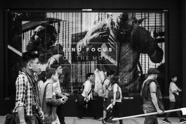 Find focus on the move. Streetphoto Men Outdoors People Arts Culture And Entertainment Crowd Streetphotography Blackandwhite Street Shadows Black And White Photography Walking Street Photography Monochrome Photography Eyeem Philippines