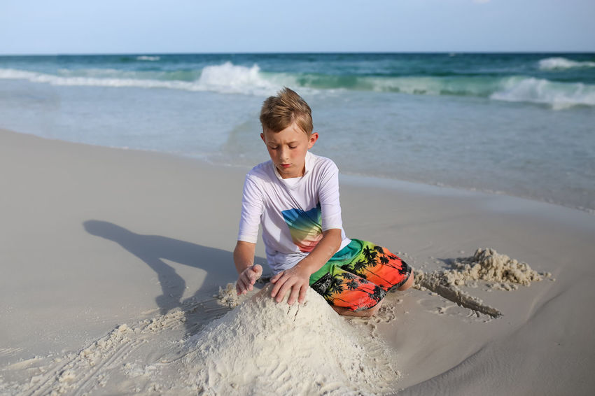 Boy playing in sand on beach Beach Beach Fun Boy Child Child Playing At The Beach Sand White Sand Ocean Water Clear Water Sunshine Sunny Day Summer Summertime Summer Vacation Beach Vacation Brother Shovel Beach Toys Digging In Sand Ocean Water Leisure Activity