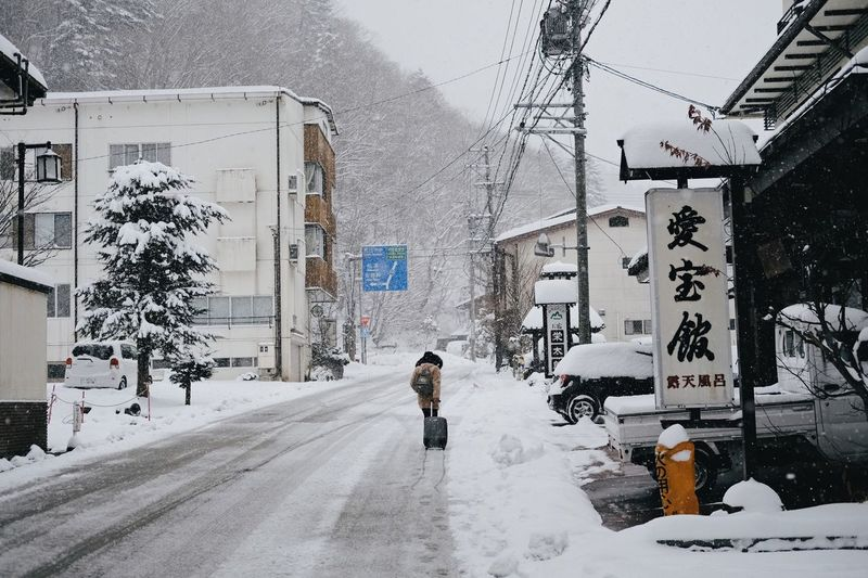 See you again, Hirayu Onsen Snow Winter Cold Temperature Weather Building Exterior Built Structure Architecture Outdoors Real People Cable Day Full Length The Way Forward Transportation One Person Nature Electricity Pylon Road Snowing Sky