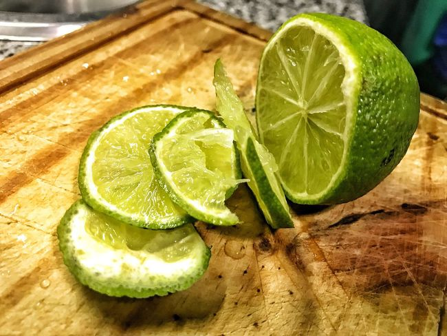 SLICE Lime Food And Drink Lemon Freshness Food Indoors  Citrus Fruit Healthy Eating Table Close-up No People Alcohol Fruit Cutting Board Drink Mojito Day Sour Taste Ready-to-eat Lemons Caipirinha Caipiroska Caipi Caipira