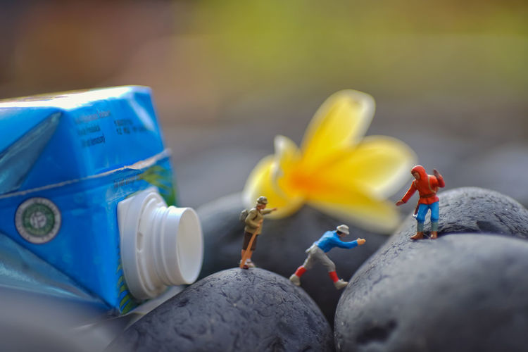 Close-up of yellow toys against blue sky