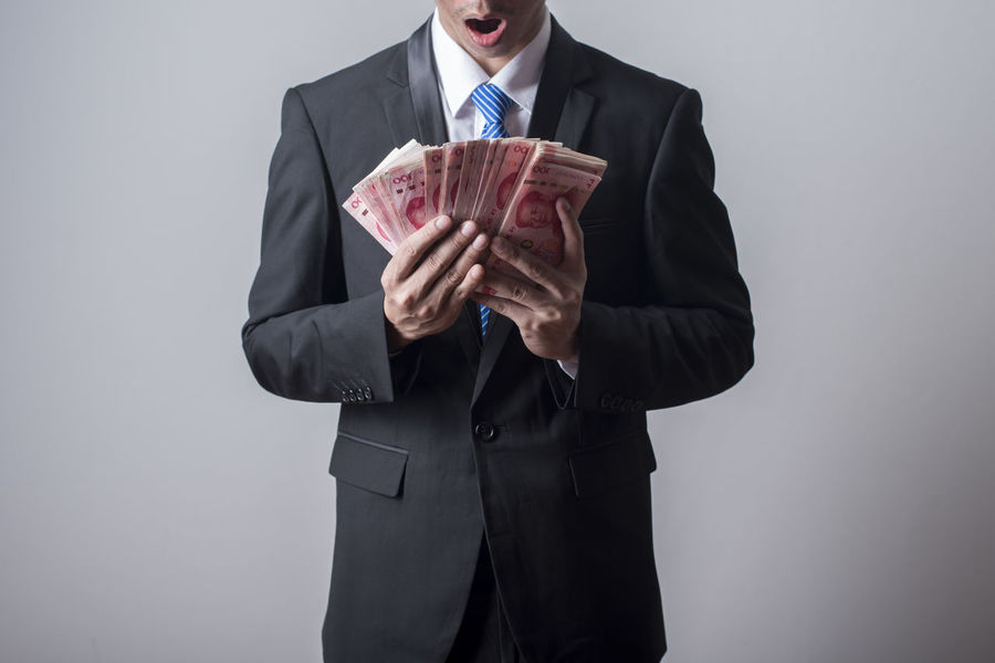 100 Business Money Money Money YUAN Adult Businessman Finance Human Hand Men One Man Only One Person People Suit Well-dressed