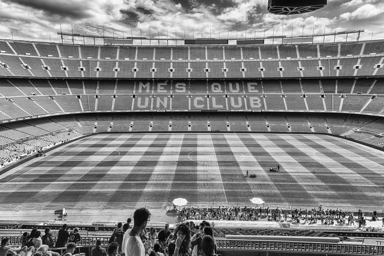 BARCELONA - AUGUST 11: Interior view of Camp Nou stadium, home of Barcelona Football Club, Catalonia, Spain, on August 11, 2017. With a seating capacity of 99,354 it is the largest stadium in Europe Group Of People Real People Crowd Large Group Of People Architecture Men Women Built Structure Adult Lifestyles Leisure Activity Stadium Day Sport Travel Destinations Travel Tourism Cloud - Sky Building Exterior Outdoors Spectator