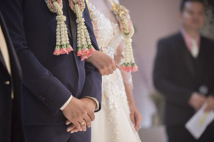 Beginnings Bonding Bride Bridegroom Celebration Celebration Event Ceremony Couple - Relationship Groom Holding Hands Husband Life Events Love Married Men Midsection Real People Togetherness Two People Wedding Wedding Ceremony Wedding Dress Well-dressed Wife Women