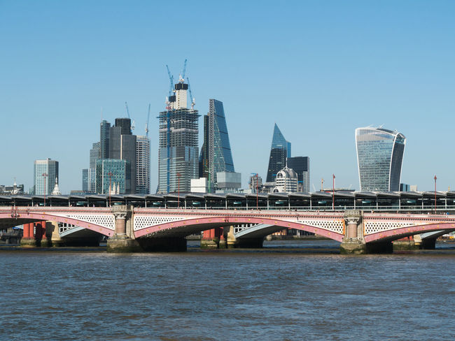 View of Blackfriars Bridge and the City of London in July 2018 Walkie Talkie Building Arch Arch Bridge Architecture Bridge Bridge - Man Made Structure Building Exterior Built Structure Cheesegrater Building City Cityscape Clear Sky Connection Day Financial District  Modern Office Building Exterior Outdoors River Sky Skyscraper Transportation Travel Water Waterfront