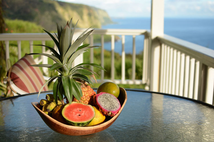 Fruits In Container On Table In Balcony