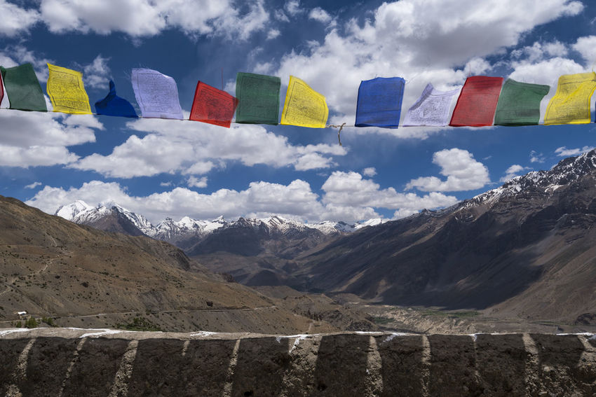 Prayer flags at Dhankar Monastery, India. Dhankar Dhankar Monastery India Monastery Travel Beauty In Nature Cloud - Sky Day Flag Flags Himachal Mountain Mountain Range Multi Colored Nature No People Outdoors Prayer Flags  Scenics Sky Snowcapped Mountain Spiti Mix Yourself A Good Time