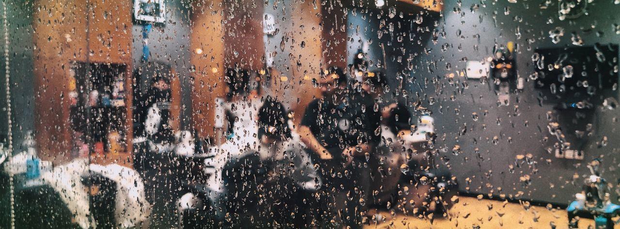 Group of people on wet window in rainy season