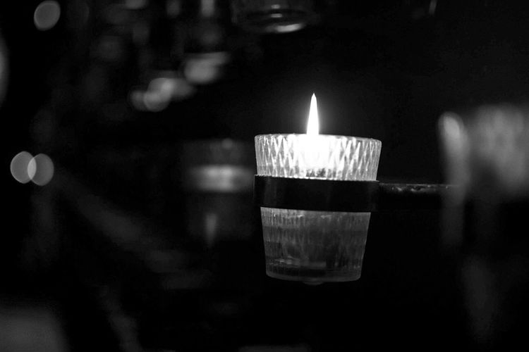 Light up the dark. Flame Night No People Indoors  Illuminated Close-up Street Bnw_society Bnw_friday_challenge Bnw_life Bnwphotography Streetphotography Bnw_collection Black And White Friday See The Light