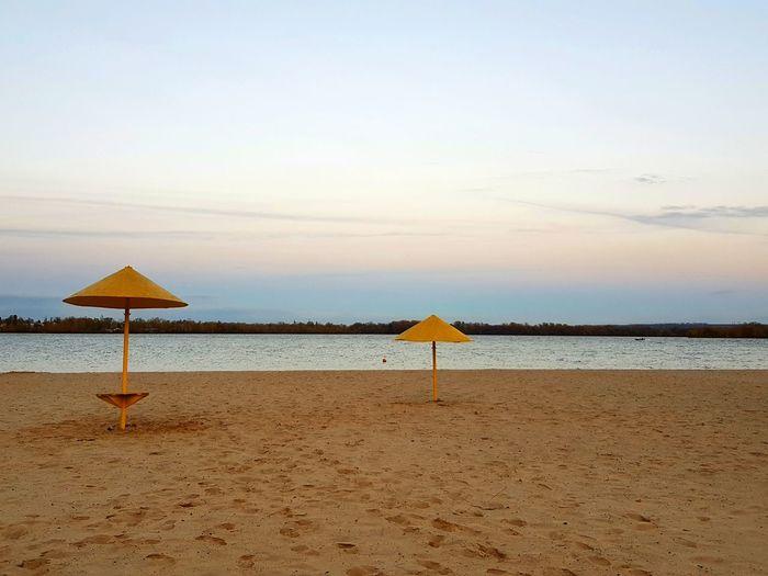 EyeEm Selects Water Sea Beach Sand Relaxation Summer Clear Sky Protection Sunset Swimming Beach Umbrella Parasol Beach Hut
