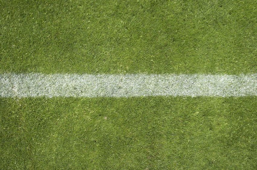 American Football - Ball American Football - Sport American Football Field Backgrounds Backgrounds Details Textures And Shapes Close Up Grass Competitive Sport Day Full Frame Grass Green Color High Angle View Nature No People Outdoors Playing Field Soccer Field Sport