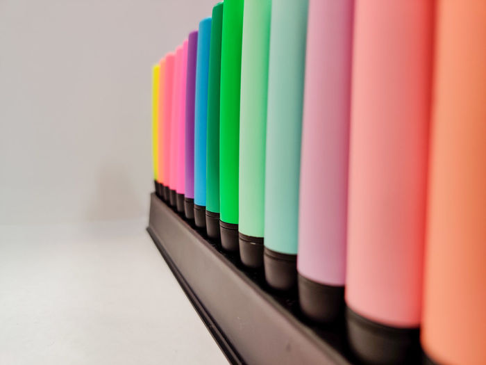 Close-up of multi colored felt tip pens on table