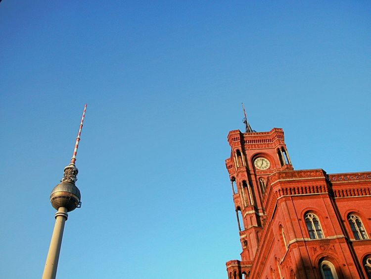 Rotes Rathaus Berlin Architecture Blue Building Exterior Built Structure City Clear Sky Clock Tower Copy Space Day Low Angle View No People Outdoors Place Of Worship Red And Blue Religion Sky Spirituality Sunlight Tower Travel Destinations Tv Tower Berlin