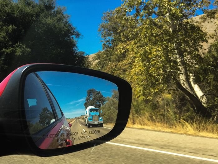 Transportation Tree Mode Of Transportation Plant Land Vehicle Motor Vehicle Side-view Mirror Car Road Reflection Nature Day One Person Sky Travel Sunlight Real People Mirror Rear-view Mirror Outdoors Road Trip Vehicle Mirror USA