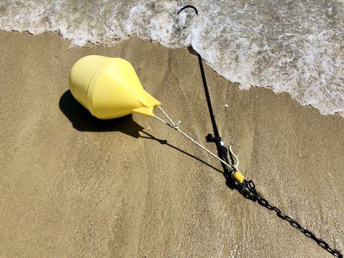 High angle view of yellow fishing net on beach