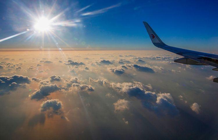好心情(1) Sky Sunlight Airplane Transportation Journey Lens Flare Sun Air Vehicle Scenics Airplane Wing Sunset Tranquility Landscape Outdoors Beauty In Nature No People Travel Nature Blue Day