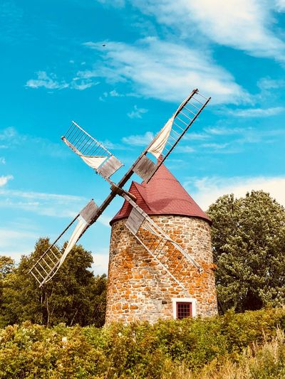 Sky Wind Power Renewable Energy Turbine Fuel And Power Generation Environmental Conservation Traditional Windmill Alternative Energy Wind Turbine Cloud - Sky Day Architecture No People Built Structure Nature Plant Environment Low Angle View Tree Rural Scene