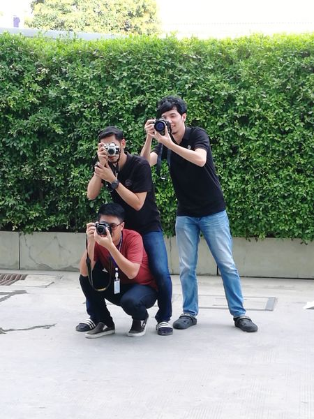 Three photographers stand up take a picture Proto Human Connection Friendship Photography Themes Photo Messaging Young Women Technology Togetherness Photographing Wireless Technology Men Skateboard Park Stunt Ramp Skating Self Portrait Aerobatics Monopod