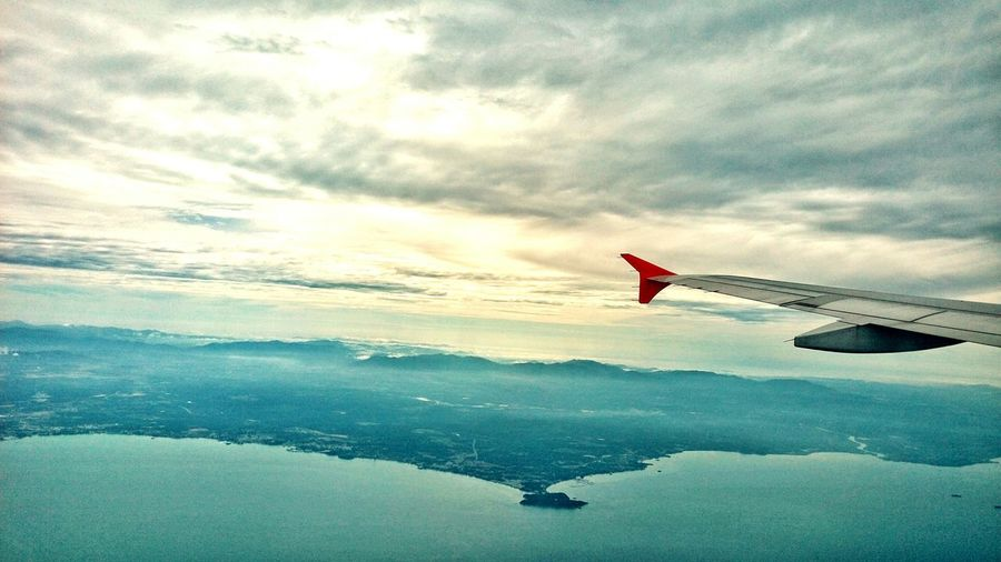 Flying Water Sea Scenics Idyllic Tranquil Scene Cloud - Sky Beauty In Nature Sky Cloud Mid-air Air Vehicle Aerial View Tranquility Blue Nature Mountain Cloudscape Ocean Majestic EyeEm Best Shots Eye4photography  Seascape Beauty In Nature