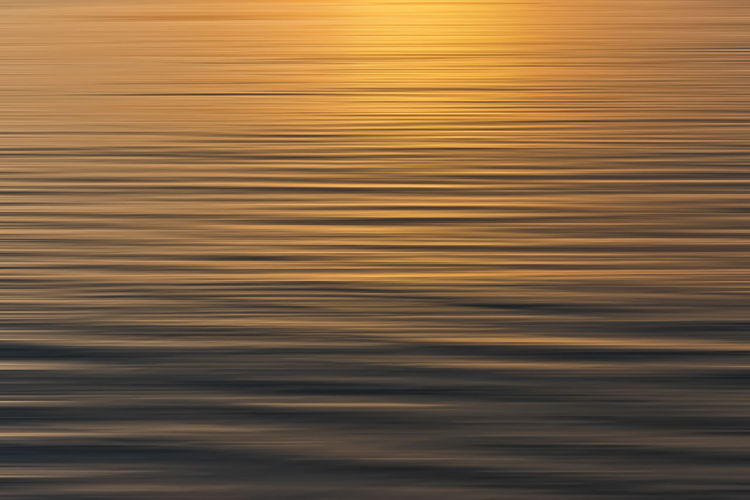 Colorful sunrise with long exposure effect, horizontal motion blurred for background Abstract Backgrounds Close-up Day Full Frame Nature No People Outdoors Reflection Sunset