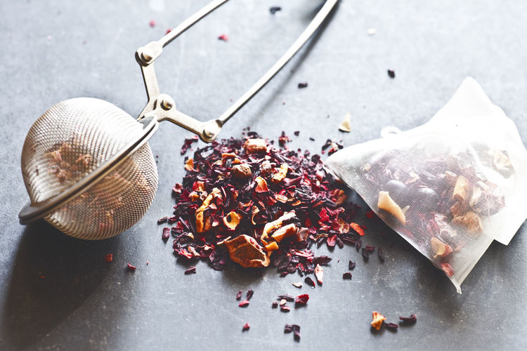Tea infuser with dried flowers on table