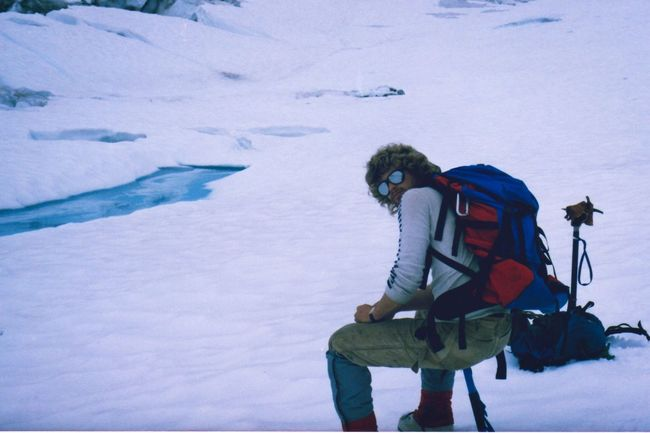 Ice Age Vaugh Lewis Icefall 1985 sitting on an ice axe