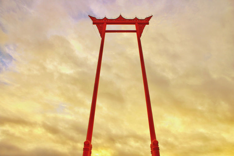 ASIA Bangkok Thailand. Sao Chingcha Architecture Built Structure Cloud - Sky Day Design Dusk Low Angle View Metal Nature No People Orange Color Outdoors Red Religion Sky Striped Sunset Travel Travel Destinations