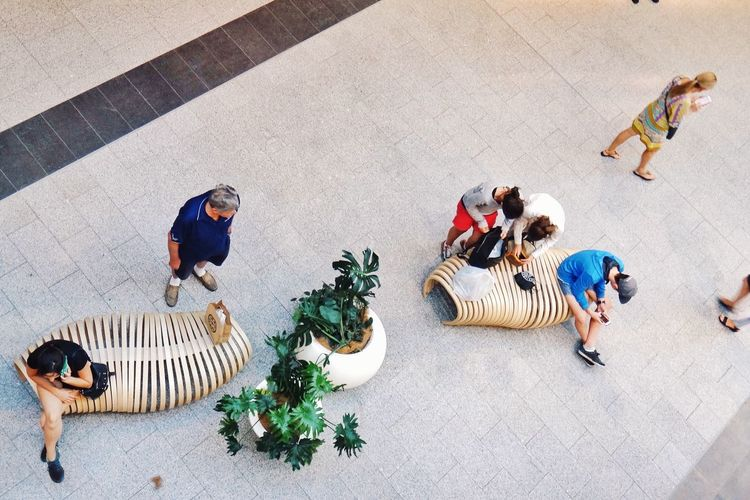 View from above of people in a shopping mall Shopping Mall People View From Above From Above  Looking Down Phone Bench Casual Clothing Streetphotography Street Photography Street The Street Photographer - 2016 EyeEm Awards Pacific Fair Broadbeach Gold Coast Eyeem Australia Australia Live Love Shop Showcase June Fine Art Photography People Together Athleisure A Bird's Eye View People And Places
