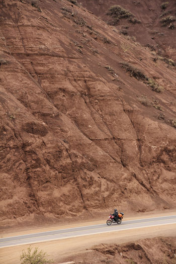 Man riding bicycle on mountain road