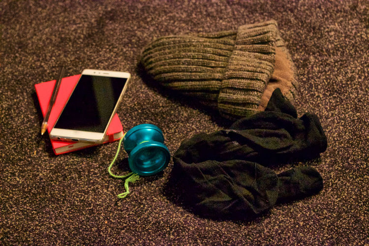 Travel essentials Composition Day Hanging Out Indoors  No People Pen Red Red Notebook Smartphone Socks Wool Hat Writing YoYo TK Maxx Socksie My Year My View Finding New Frontiers