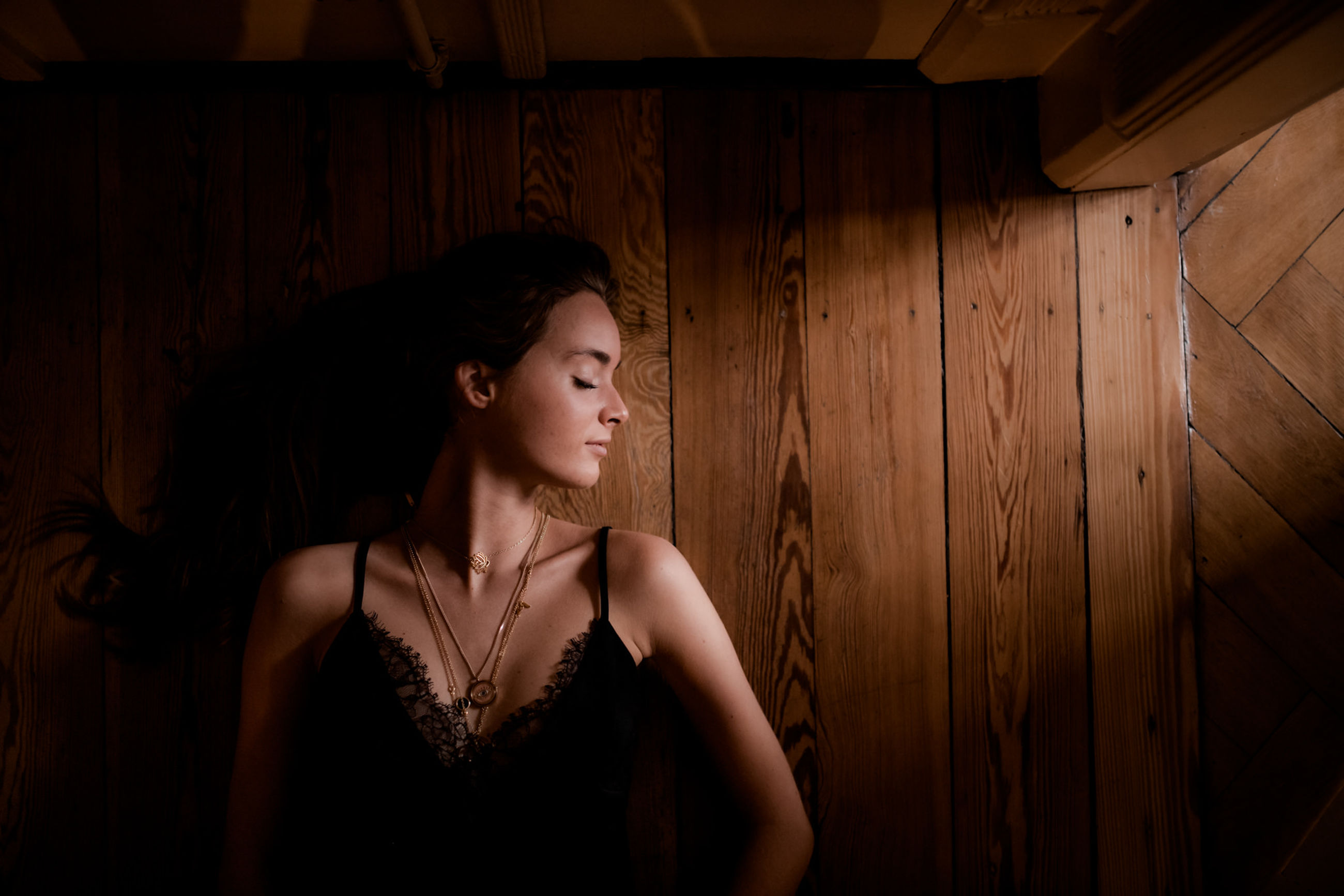 one person, indoors, young adult, women, young women, real people, looking, beauty, beautiful woman, looking away, standing, contemplation, fashion, leisure activity, adult, hairstyle, lifestyles, hair, waist up, wood