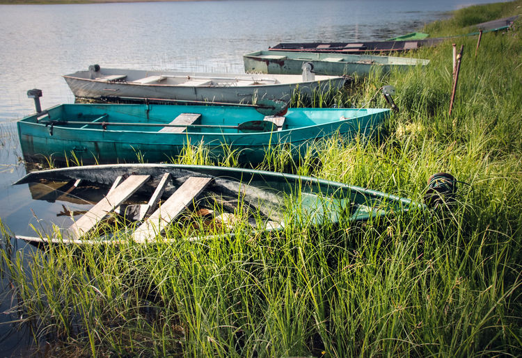 Fishing Boats Sink Abandoned Architecture Built Structure Day Fishing Boat Grass Lake Land Mode Of Transportation Moored Nature Nautical Vessel No People Outdoors Plant Rowboat Small Boat Tranquility Transportation Travel Water