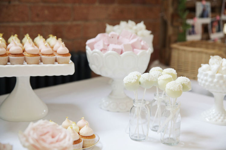 Wedding Cake Stand Wedding Arrangement Cake Candy Close-up Cupcake Day Dessert Flower Food Food And Drink Freshness Indoors  Indulgence Large Group Of Objects No People Ready-to-eat Sugar Sweet Food Table Temptation Unhealthy Eating Wedding Wedding Cake White Color