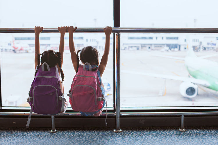 Airline Airplane Airport Arrival Asian  Backpack Bag Baggage Boarding Child Children Cute Departure Destination Enjoy Family Flight Gate Girl Hall Happy Holiday Indoor Inside International Journey Kid Leisure Lifestyle Looking Luggage Passenger People Plane Sibling Sister Suitcase Terminal Thai Together Tourism Tourist Transit Transportation Travel Trip Vacation Voyage Waiting Young