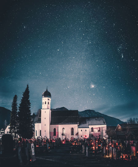 Church against star field at night