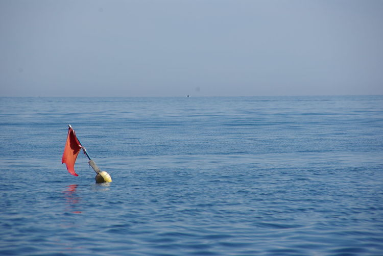 Blue Buoy Buoy On The Water Horizon Over Water No People Outdoors Scenics Sea Vacations Water Waterfront