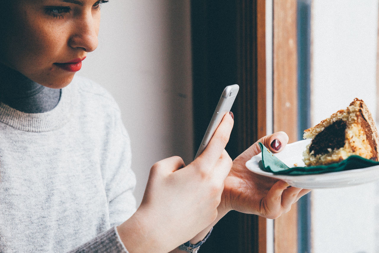 Woman Photographing Pastry With Mobile Phone