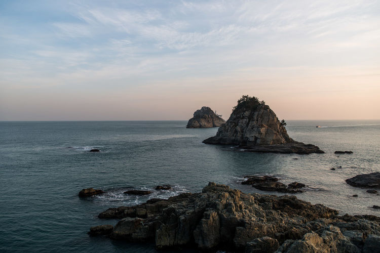 Sea Sky Rock Water Scenics - Nature Rock - Object Solid Beauty In Nature Horizon Over Water Horizon Tranquility Rock Formation Tranquil Scene Sunset Cloud - Sky Nature Land Idyllic Beach No People Outdoors Stack Rock Rocky Coastline Eroded
