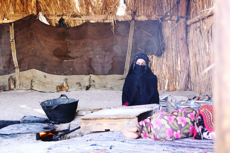 Woman Sitting In Hut