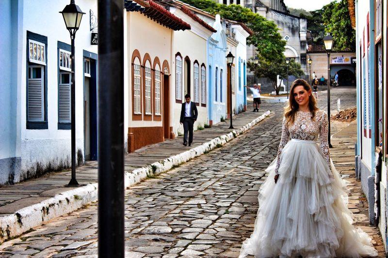 Bride walking on street