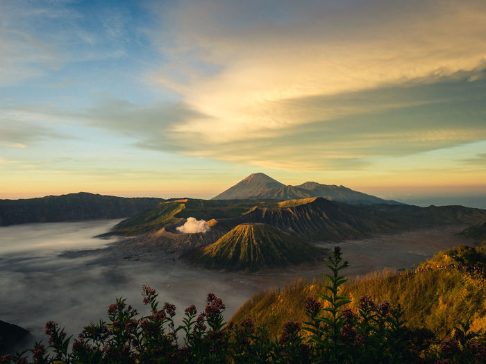 Scenic view of vulcanic landscape against cloudy sky during sunrise