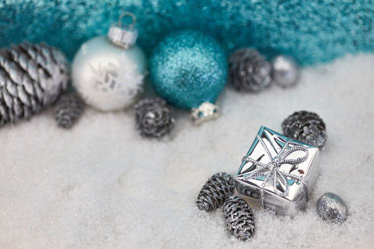 High angle view of christmas gift in snow