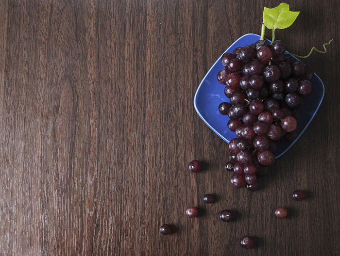 Grapes on blue