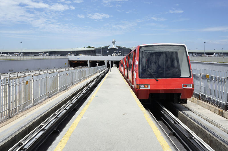 Airport train in front of airport