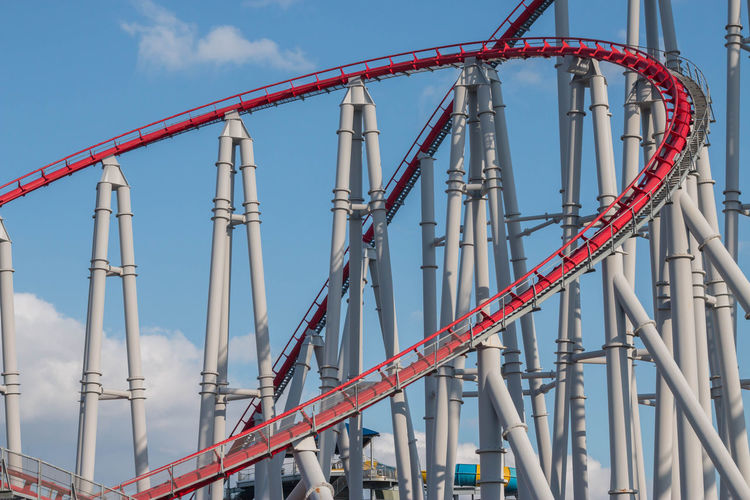 Roller Coaster Amusement Park Amusement Park Ride Architecture Arts Culture And Entertainment Building Exterior Built Structure Cloud - Sky Connection Day Industry Low Angle View Machinery Metal Nature No People Outdoors Railing Red Rollercoaster Sky