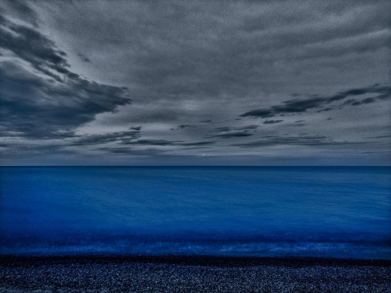 sea, horizon over water, water, tranquil scene, sky, cloud - sky, scenics, beach, tranquility, beauty in nature, nature, no people, outdoors, blue, storm cloud, day