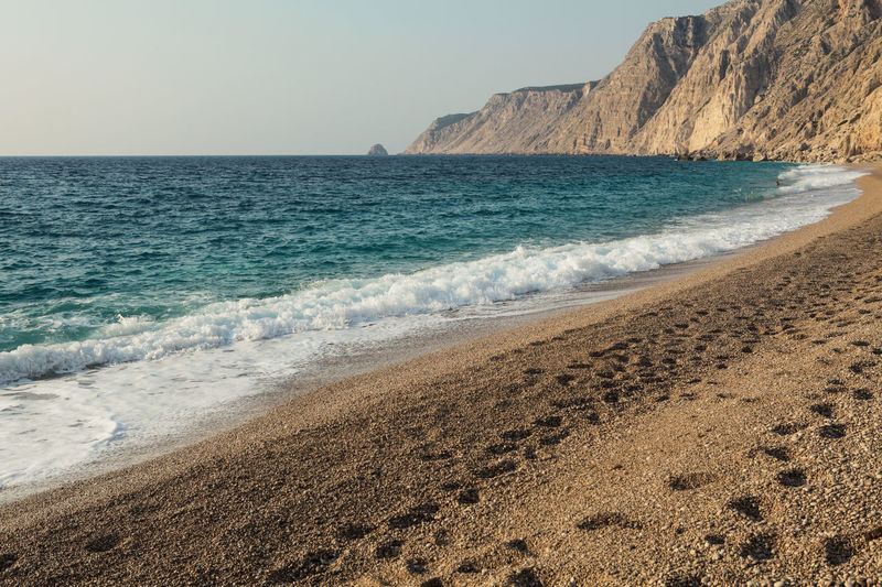 Empty Platia Ammos Beach Sea Beach Beauty In Nature Horizon Over Water Horizon Scenics - Nature Sand Sky Motion Wave Aquatic Sport Surfing Nature Tranquility Tranquil Scene Outdoors Pebbles Wave Foam Rocks Empty Footsteps Turquoise Golden Hour